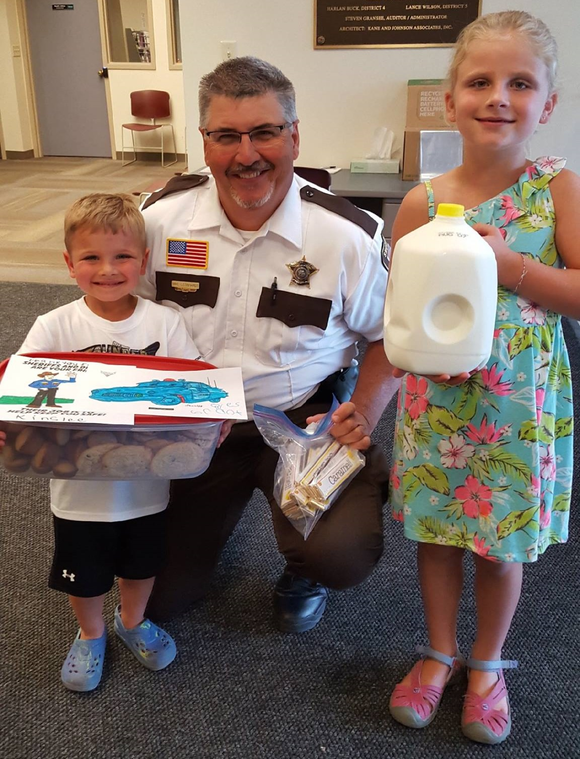 Chief Deputy Mike Leonhardt with some supporters bringing treats for the Deputies