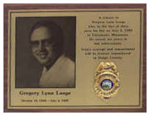 greg lange plaque displayed in Annex of Courthouse